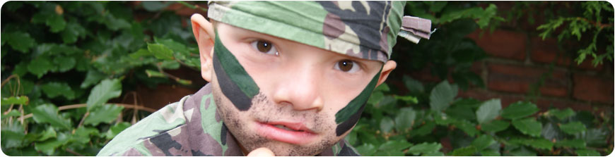 Boy dressed in army costume for party